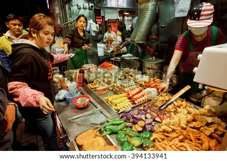 HONG KONG, CHINA - FEB 10: Customers buying meals at fast-food restaurant stall with meat dishes and grilled seafood on February 10, 2016. More than 47 million tourists visit Hong Kong annually  - stock photo