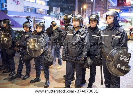 HONG KONG, CHINA - 09 FEB 2016: Hong Kong, Chinese New Year riot. Police setup blockage in Hong Kong main street Nathan Road.