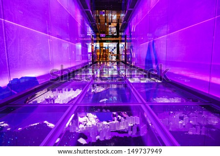 HONG KONG, CHINA - FEBRUARY 21: Colorful corridor in Sky100 on February, 21, 2013, Hong Kong, China. Sky100 is a observation deck on the 100th floor of the International Commerce Centre - stock photo