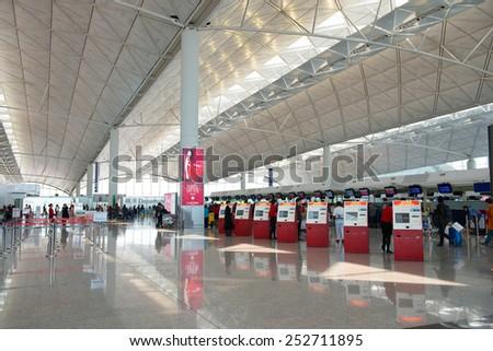 HONG KONG, CHINA - FEBRUARY 07: Passengers in the airport main lobby of Hong Kong airport on February, 07, 2015 in Hong Kong, China. Hong Kong airport handles more than 55 million passengers per year - stock photo