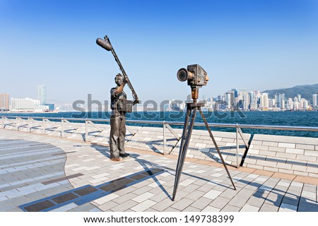 HONG KONG, CHINA - FEBRUARY 21: Statues and skyline on Avenue of Stars on February 21, 2013 in Hong Kong, China. The promenade honours celebrities of the HK film industry as the famous city attraction - stock photo