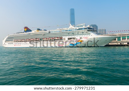 HONG KONG, CHINA - 18 JAN 2015: A luxury cruise liner, the Superstar Virgo from Star Cruises, moored and waiting for passengers at the central pier in Kowloon. - stock photo