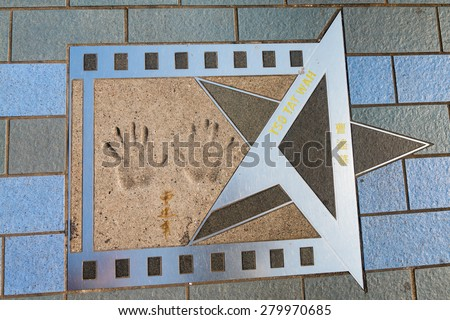 HONG KONG, CHINA - 18 JAN 2015: Handprints, signature and printed name of Tso Tat Wah, a well known Chinese celebrity, on the Avenue of the Stars at Kowloon Promenade, in Hong Kong. - stock photo