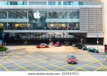 HONG KONG, CHINA- 10 JAN 2015: Section of an enormous shopping mall containing a popular electronics store, built over a major urban street in downtown Hong Kong, China.