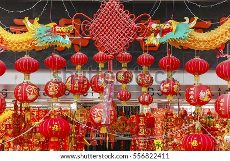 HONG KONG , CHINA - JAN. 16 : Shop selling traditional clothing and decoration stuffs for Chinese New Year on Jan 16, 2013 in Hong kong