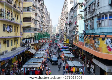 HONG KONG, CHINA - JANUARY 23, 2015: Many street vendors selling products on Fa Yuen Street between the buildings. People walk in the busy district of Mong Kok, Kowloon, Hong Kong. - stock photo