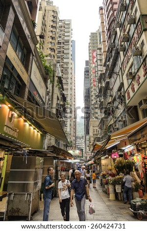 HONG KONG , CHINA - JULY 7 : Hong Kong city. High-rise buildings In the district area below, often there is a point in trading activity and the interest of tourist. on July 7, 2014 in Hong Kong, CHINA