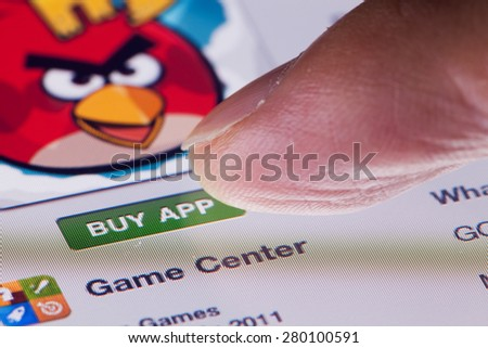 Hong Kong, China - July 31, 2011: Macro image of an ipad, showing the action of clicking the 'BUY APP' button in App Store - stock photo