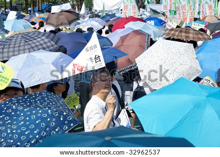 HONG KONG, CHINA, - JULY 1: On a hot day, thousand of people in Hong Kong, China, participate at the annual July 1, 2009 march to demand democracy and against the government - stock photo