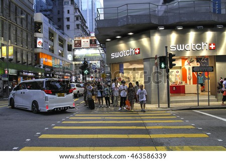 HONG KONG,CHINA, JULY 3 2016: Pedestrians rush through a very busy road in the shopping district of Causeway Bay in Hong Kong island