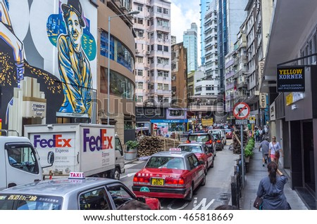 Hong Kong, China - July 1st. 2016 - Big concentration of cars and people in the streets of downtonw Hong Kong in China, Asia.