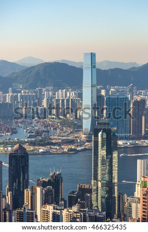 Hong Kong, China - July 1st. 2016 - The high view of Hong Kong from the Victoria peak outlook on a late sunset in China.
