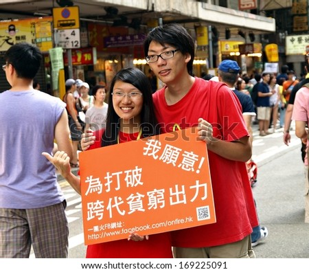 HONG KONG, CHINA - JULY 1: Unidentified Hong Kong citizens participate in the annual July 1 march to demand support people in poverty on July 1, 2012 in Hong Kong, China.