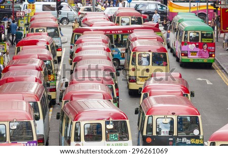 Hong Kong, China - June 2, 2015: Minibuses lining up, waiting for passengers at a busy station in Mongkok, Hong Kong - stock photo