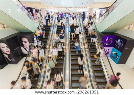 Hong Kong, China - June 2, 2015: People riding on escalators in a busy shopping mall in Hong Kong - stock photo