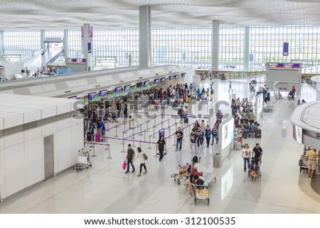 Hong Kong, China - June 23, 2015: Travelers at the check-in counters of Hong Kong International Airport - stock photo