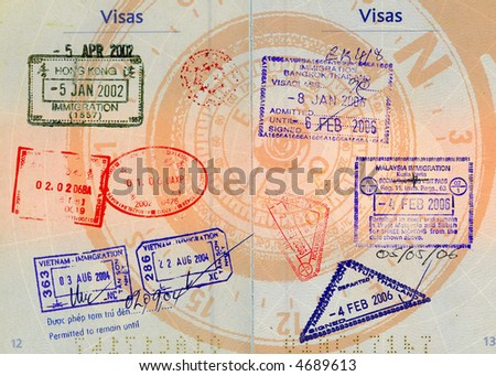 hong kong,china,malaysia,thailand and vietnam stamps on french passport with compass in backgrounds high definition scan - stock photo