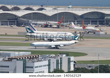 HONG KONG, CHINA - MARCH 31: Hong Kong International Airport on March 31, 2011 in Hong Kong, China . The airport is named the World's Best Airport in the annual passenger survey by Skytrax. - stock photo
