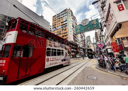 HONG KONG, CHINA - MAY 19, 2014: City trams with double deckers and city buildings on may 19, 2014 in Hong Kong