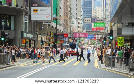 HONG KONG, CHINA-MAY 25:  Office people and shoppers congest Queen Road Central.  The area is one of the most populated in the world with 2 million people in 47 sq/km. May 25, 2007 in Hong Kong China - stock photo