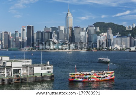 HONG KONG,CHINA - MAY 24 : Victoia Harbor on May 24, 2013 in Hong Kong. Hong Kong is an international financial centre that has 112 buildings that stand taller than 180 meters  - stock photo