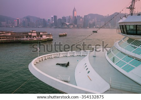 HONG KONG, CHINA - NOV 19: Big Cruise Ship berth at Victoria Harbor on Nov 19, 2014 in Hong Kong, Hongkong is a major tourist city in Asia,More than 40000000 visitors a year.