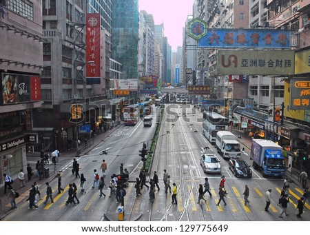 HONG KONG, CHINA-Â?Â?NOVEMBER 23:  Office people and shoppers congest Hennessy Road. This area is internationally famous for business, finance, shopping. November 23, 2007 in Hong Kong, China - stock photo