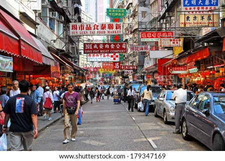 HONG KONG, CHINA-NOVEMBER 17: Office people and shoppers congest Wan Chai Road. The area is one of the most populated in the world, 2 million people in 47 square km. November 17, 2007 Hong Kong China - stock photo