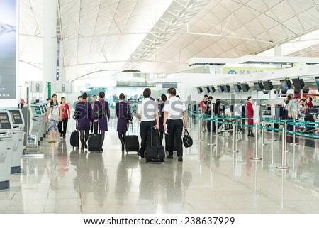 Hong Kong, China - November 01: Pilots and air walking in the lobby of Hong Kong airport on November, 01, 2014 in Hong Kong, China. Hong Kong airport handles many air line per year. - stock photo