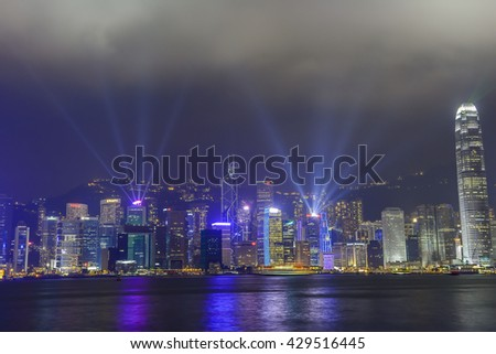HONG KONG, CHINA - OCTOBER 2013: A Symphony of Lights show on the skyline - stock photo