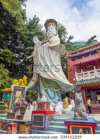 Hong Kong, China - October 03, 2015 : Big  Quan Yin statue at Kwum Yam Taoist shrine at the southeastern end of Repulse Bay - stock photo