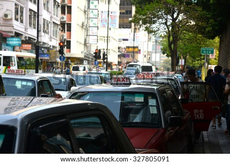Hong Kong, China - October 1, 2015: Hong Kong Taxi Queuing at the Taxi Stand Waiting For passenger.