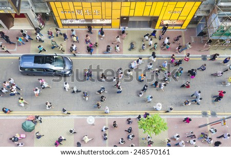 Hong Kong, China - October 19, 2013: Pedestrians walking on a street in Causeway Bay, Hong Kong. Causeway Bay is a major shopping district, and one of the most crowded area in Hong Kong - stock photo