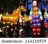 HONG KONG, CHINA - SEPTEMBER 22: Chinese lanterns showing Xian Terracotta Army light up to celebrate the mid-autumn festival, also known as moon festival, on September 22, 2012 in Hong Kong, China. - stock photo