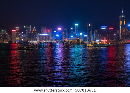 HONG KONG, CHINA - SEPTEMBER 16, 2016: Hong Kong city skyline at night over Victoria Harbor with clear sky and urban skyscrapers, taken from Tsim Sha Tsui, Kowloon