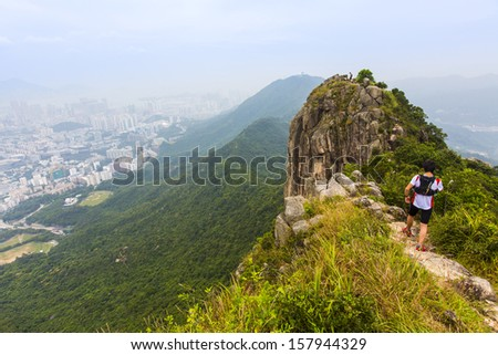 HONG KONG, CHINA - 29 SEPTEMBER 2013 - Peak of Lion Rock with a climber, on 29 Sept 2013, in Kowloon, Hong Kong.