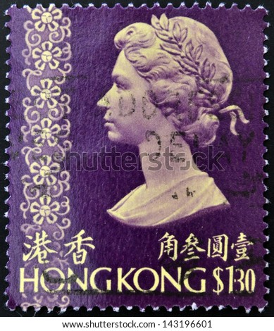 HONG KONG - CIRCA 1973: A stamp printed in Hong Kong shows a portrait of Queen Elizabeth II, circa 1973. - stock photo