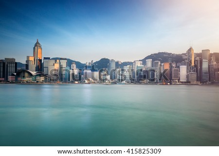 Hong kong city skyline at night over victoria harbor with clear sky and urban skyscrapers, Hong Kong Special Administrative Region of the People's Republic of China, Hong Kong - stock photo