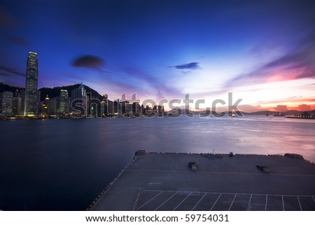 Hong Kong cityscape in sunset and dock