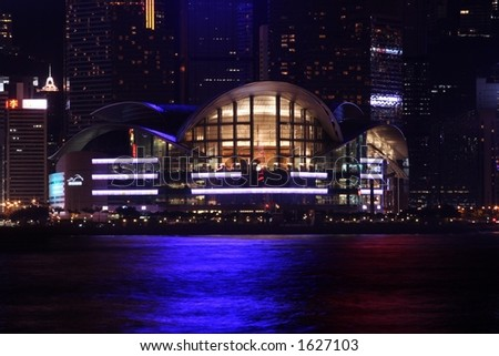 Hong Kong Convention And Exhibition Centre at night. - stock photo