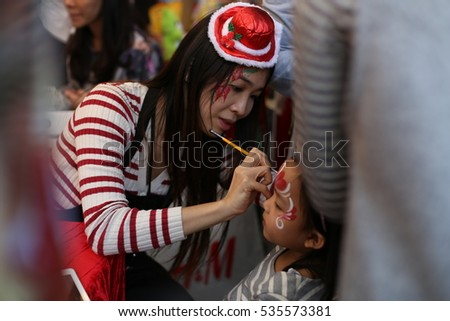 HONG KONG - 10 DEC: Face Painting in Stanley Plaza Enchanted Christmas Market in Stanley, Hong Kong on 10 December 2016