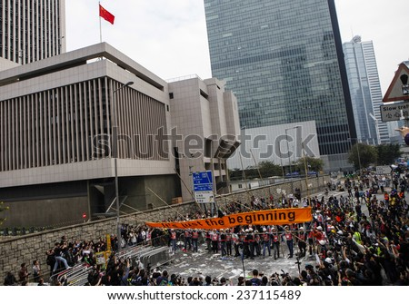 HONG KONG, DEC. 11. 2014: Workers and police remove barricades at an area blocked by pro-democracy protesters near the PLA headquarters, as today is the last day of the protest. - stock photo