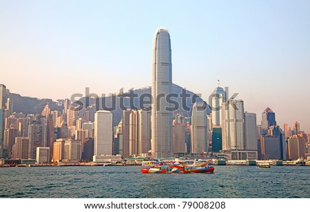 HONG KONG - DECEMBER 3: Ferry cruising Victoria harbor in the morning on December 3, 2010 in Hong Kong. Ferry is in operation for more than 120 years and is one of the main tourist attractions. - stock photo