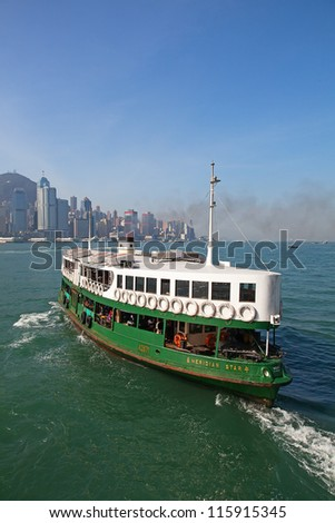 "HONG KONG - DECEMBER 3: Ferry ""Meridian star"" leaving Kowloon pier on December 3, 2010 in Hong Kong, China. Hong Kong ferry is in operation for more than 120 years and one of attractions of the city. - stock photo"