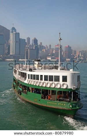 "HONG KONG - DECEMBER 3: Ferry ""Meridian star"" leaving Kowloon pier on December 3, 2010 in Hong Kong. Ferry is in operation for more than 120 years and it is one main tourist attractions of the city. - stock photo"