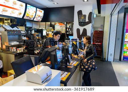 HONG KONG - DECEMBER 25, 2015: interior of McDonald's restaurant. McDonald's is the world's largest chain of hamburger fast food restaurants, founded in the United States. - stock photo