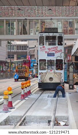 HONG KONG - DECEMBER 05: Unidentified people using city tram in Hong Kong on December 05, 2010. Tram in Hong Kong is the only tram system in the world run with double deckers.