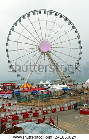HONG KONG - DECTEMBER 26,2014 : Ferris Wheel landmark in Hong Kong City at dusk - stock photo