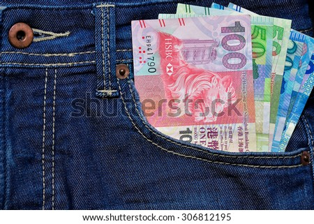 Hong Kong Dollar currency in Jean's pocket