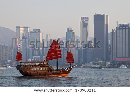 HONG KONG-FEB. 5, 2011: A Sunset View of Victoria Harbor in Hong Kong which is one of the most densely populated areas in the world and the third most important leading international financial center. - stock photo